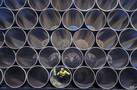 FILE - In this Dec. 6, 2016 file photo tubes are stored in Sassnitz, Germany, to construct the natural gas pipeline Nord Stream…
