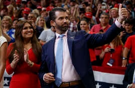 Donald Trump Jr. and Kimberly Guilfoyle arrive for President Donald Trump's re-election kickoff rally at the Amway Center,…