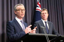 Australian Government Leader in the House of Representatives Christopher Pyne, left, and Attorney-General Christian Porter…