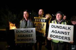 Protesters from the Border Communities Against Brexit group hold a demonstration on the Irish border on the Republic of Ireland…