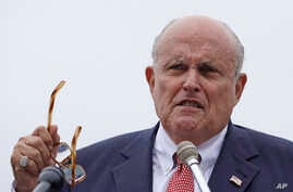 FILE - In this Aug. 1, 2018, file photo, Rudy Giuliani, an attorney for President Donald Trump, speaks in Portsmouth, N.H. On…
