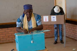 An elderly woman votes in Botswana's general elections in Moshupa, some 45kms (30 miles) West of Gaborone, Wednesday, Oct. 23,…