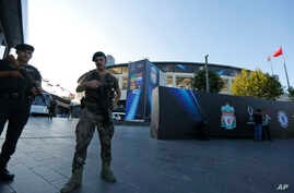 Turkish police officers provide security outside Besiktas Park in Istanbul