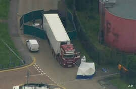 An aerial view as police forensic officers attend the scene after a truck was found to contain a large number of dead bodies,…