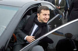 "Ukrainian President Volodymyr Zelenskiy leaves the car to attend a business forum ""RE:THINK. Invest In Ukraine"" in Mariupol,…"