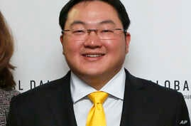 FILE - In this April 23, 2015 file photo, Jho Low, Director of the Jynwel Foundation, poses at the launch of the Global Daily…
