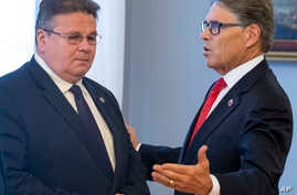 U.S. Energy Secretary Rick Perry, right, speaks to the Lithuania's Foreign Minister Linas Linkevicius.