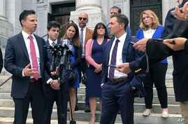 Attorneys Joshua Koskoff, left, and Christopher Mattei, right, representing parents, rear, of children killed in the 2012 Sandy…