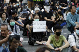 Protesters gather during a rally in Hong Kong, Friday, Nov. 15, 2019. Protesters who had barricaded themselves in a Hong Kong…
