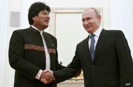 Russian President Vladimir Putin, right, shakes hands with Bolivia's President Evo Morales prior to their talks in the Kremlin,…
