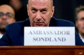 Ambassador Gordon Sondland, U.S. Ambassador to the European Union, center, appears before the House Intelligence Committee on…