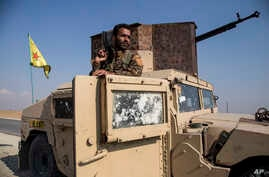 Kurdish forces withdraw from from an area near Turkish border with Syria, overseen by the Russian forces, near the town of…