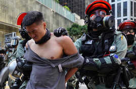 A protester is detained in Central district of Hong Kong on Monday, Nov. 11, 2019. A Hong Kong protester was shot by police…