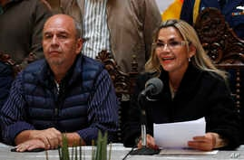 Accompanied by Government Minister Arturo Murillo, Bolivia's interim President Jeanine Anez speaks during a press conference at…