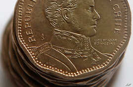 A Chilean 50 peso coin is seen in Santiago, Friday, Feb. 12, 2010. More than a million of the coins were printed in 2008  with…