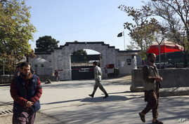 Security walks in front of the Pakistan Embassy in Kabul