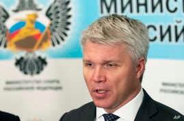 FILE - In this file photo dated July 24, 2019, Russian Sports Minister Pavel Kolobkov speaks to the media in Moscow