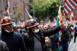 Supporters of former President Evo Morales march in La Paz, Bolivia, Friday, Nov. 15, 2019. Morales resigned following massive…