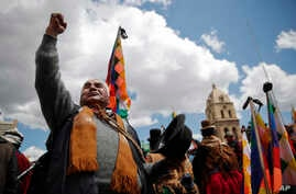 Supporters of former President Evo Morales rally in La Paz, Bolivia, Monday, Nov. 18, 2019. Morales's backers have taken to the…