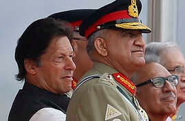 In this March 23, 2019 photo, Pakistan's Army Chief Gen. Qamar Javed Bajwa, center, watches a parade with Prime Minister Imran…