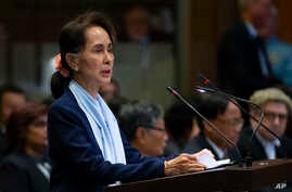 Myanmar's leader Aung San Suu Kyi addresses judges of the International Court of Justice for the second day of three days of…