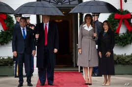 President Donald Trump and first lady Melania Trump pose for photos with Guatemalan President Jimmy Morales and his wife…