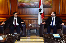 In this photo released by Lebanon's official government photographer Dalati Nohra, newly-assigned Lebanese Prime Minister,…