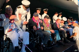 Retired U.S. Navy Cmdr. Don Long, left, and other Pearl Harbor survivors talk before the 78th anniversary of the Japanese…