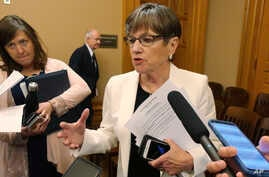 Kansas Gov. Laura Kelly speaks with reporters following a meeting with top legislative leaders, Wednesday, June 5, 2019, at the…