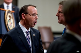Deputy Attorney General Rod Rosenstein, left, speaks with former White House Counsel Don McGahn, right, following a farewell…