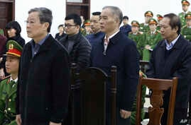Vietnamese former Minister of information and communication Nguyen Bac Son, left, valuer Hoang Duy Quang, second left, former…