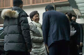 Hong Kong Chief Executive Carrie Lam is greeted as she arrives at a hotel in Beijing on Saturday, Dec. 14, 2019. (AP Photo/Ng…