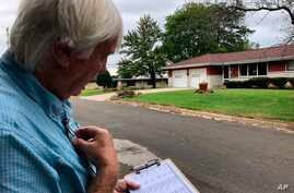 Democratic organizer Bill Chandler reviews his voter contact sheet while canvassing on Saturday, Sept. 21, 2019, in Whitewater,…