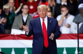 President Donald Trump arrives at a campaign rally in Battle Creek, Mich., Wednesday, Dec. 18, 2019. (AP Photo/Paul Sancya)
