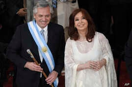 Argentina's new President Alberto Fernandez and Vice President Cristina Fernandez de Kirchner smile after they took the oath of…