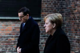 German Chancellor Angela Merkel, right, and Polish Prime Minister Mateusz Morawiecki attend a wreath laying ceremony at the…