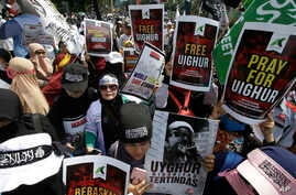 Muslim protesters rally outside China's embassy in Jakarta, Indonesia, Friday, Dec. 21, 2018. Several hundred protesters…