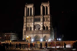 Notre Dame cathedral is pictured in Paris, Tuesday, Dec. 24, 2019. Notre Dame Cathedral is unable to host Christmas services…