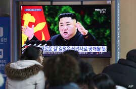 People watch a TV screen showing an image of North Korean leader Kim Jong Un during a news program at the Seoul Railway Station…
