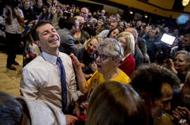 Democratic presidential candidate former South Bend, Ind., Mayor Pete Buttigieg, left, reacts as he greets members of the…