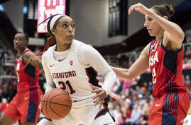 Stanford guard DiJonai Carrington (21) dribbles as Team USA guard Diana Taurasi, right, defends in the fourth quarter of an…