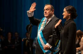 Alejandro Giammattei waves to the crowd accompanied by his daughter Ana Marcela after he was sworn-in as president of Guatemala…