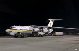In this handout photo provided by the Ukrainian Presidential Press Office, the plane carrying Ukrainian experts prepares to…