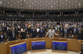 MEP's sing and hold hands after a vote on the UK's withdrawal from the EU, the final legislative step in the Brexit proceedings…