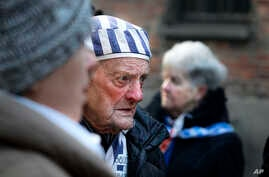 A survivor attends commemorations at the Auschwitz Nazi death camp in Oswiecim, Poland, Monday, Jan. 27, 2020. Survivors of the…