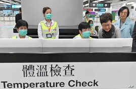 In this Friday, Jan. 3, 2020, photo released by Hong Kong Government Information Service, Hong Kong Chief Executive Carrie Lam,…