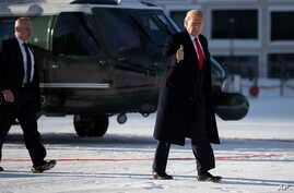 US President Donald Trump gestures as he arrives in Davos, Switzerland on Marine One, Tuesday, Jan. 21, 2020. President Trump…