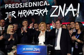 Incumbent president and presidential candidate Kolinda Grabar Kitarovic, center, addresses to her supporters in Zagreb, Croatia…