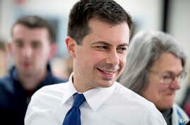 Democratic presidential candidate former South Bend, Ind., Mayor Pete Buttigieg greats members of the audience at a campaign…