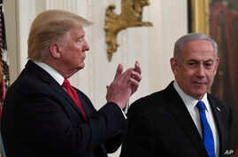 President Donald Trump, left, listens as Israeli Prime Minister Benjamin Netanyahu, right, speaks during an event in the East…